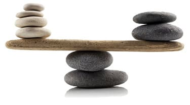 A balanced scale made of stones